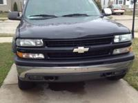 02 Z-71 suburban, 5.8 vortec, body has dents (can view