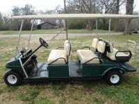 1997 CLUB CAR LIMO GOLF CART 6 SEATER. GAS POWERED
