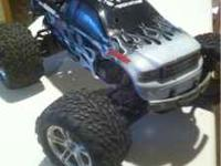 For sale, a 3.3 Traxxas T-Maxx. Converted to 2 wheel