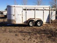 This is a 93 Three Horse Slant Load Trailer. It has a