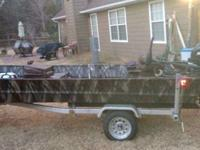 very nice quality boat with NEW motor. camo inside and