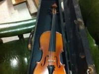 Pre 1900 3/4 sized violin. This is a very rare item.