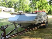 1988 Sylvan Deck Boat. has 4 cyl OMC Cobra