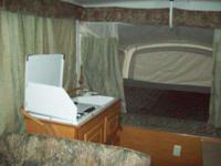 2001 coleman pop up camperqueen size bed on 1 side ,