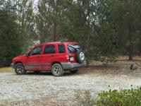 2004 Chevy Tracker. Red. 4 door. Automatic