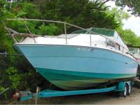 This beautiful TWIN CABIN cruiser is 27 long with a