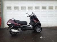 Great 3 wheeled scooter. Under 1800 miles. Fun,
