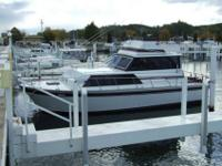A 1983 32' Marinette 32 Sedan Flybridge cabin cruiser