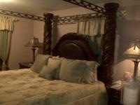 An Elegant Four Post bedroom set w/exquisite design.