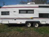 its a pull behind white camper. has a brand new