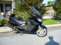 Buy this Black Burgman 650 super scooter now and be