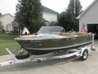 1970 Century Chetah 16 ft green hull tan