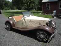 Here is a 1952 MG TD Kit car that was built in 1981