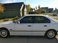 1995 BMW 530i with 174,500 miles. Tires are under a