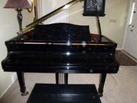 Pearl River Baby Grand in glossy black, its in