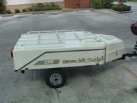 Small pop-up camper trailer for pulling behind a