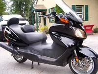 For sale is this Black Burgman 650 super scooter. This