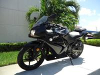 This is a gorgeous 2008 Kawasaki Nonja 250R with only