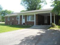 Very attractive brick home with 3 bedrooms and a bath.