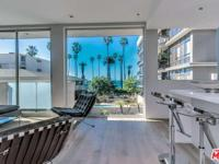 Modern, new construction, ocean view condo in small