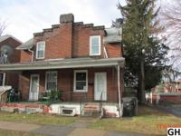 2 story brick, semi-detached home on a corner lot. 3