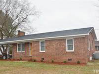 Adorable brick ranch w/ attached carport! Newly