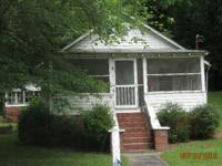 This property has 7.07 Acres of unrestricted, wooded,