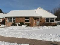 Fantastic brick ranch home offers a very large driveway