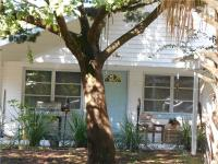 Beach side home. A short walk to the beach. A canopy of