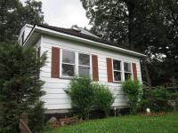 Charming Raised Ranch features 3 bedrooms 1.5 baths,