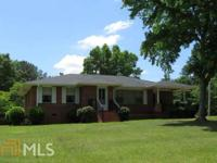 Wonderful all brick 3br/1ba home on five acres. So