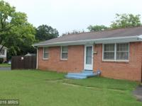 All brick rambler located on a large corner lot which