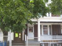 Updated townhouse style row house. This home offers