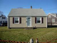 Great starter home on large corner lot with detached