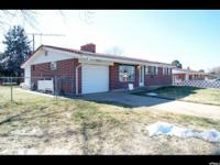 Single level brick rambler with hardwood floors,