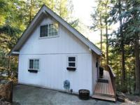 Investor alert! This darling 3 bedroom chalet set back