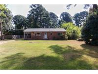 Charming brick rancher with 3 bedrooms and 1 full bath.