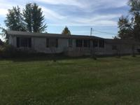 Three bedroom one bath home located on 2.44 acres of