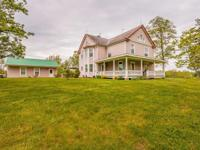 Stately farmhouse situated on scenic, rolling land!