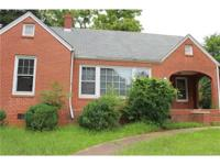 Solid Brick Construction, Hardwood floors. Large rooms.
