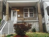 Charming brick rowhouse located close to restaurants,