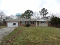 Brick ranch with full basement on 4.43 +/- acres in the