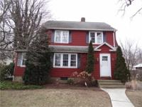 Classic 1929 Colonial located on a desirable tree lined