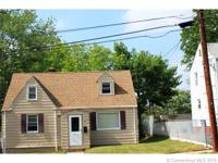 Nice three bedroom cape with potential for a fourth