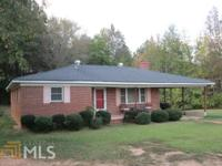 Cozy Brick Ranch is located within minutes to KIA,