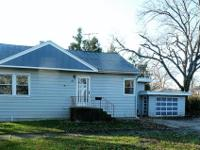 Great starter home on a large corner lot! Hardwood &