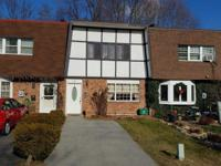 This desireably located townhome needs TLC. With