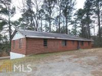 Brick ranch on quiet spacious lot. Walk in and