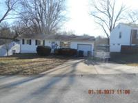 Ranch style home with 1 car attached garage. There are