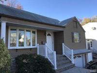Well maintained cape cod, living rm & dining rm open